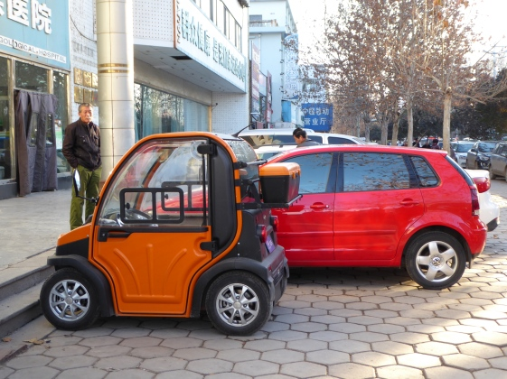 1.with mini EV you are only half a human being but you pay the same parking fee (2 yuan), Liaoccheg, Shandong