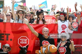 AIRLIE BEACH, AUSTRALIA - APRIL 26: Bob Brown (c) poses for a photo with supporters during a anti Adani Carmichael Coal Mine rally on April 26, 2019 in Airlie Beach, Australia. Former Greens leader and conservationist, Bob Brown, has been leading a convoy of environmental activists through the Southern States towards Central Queensland as part of the #StopAdani movement. With primary concerns for increased coal ship travel through the Great Barrier Reef World Heritage Area, unlocking of the Galilee Basin and increase in carbon pollution. The proposed Adani Carmichael Mine, if approved will be constructed in the North Galilee Basin, 160kms north-west of regional town Clermont, its first stage is estimated to produce 27.5 million tonnes of coal per annum and will be transported via rail to Abbot Point which is situated 25km north of Bowen. (Photo by Lisa Maree Williams/Getty Images)