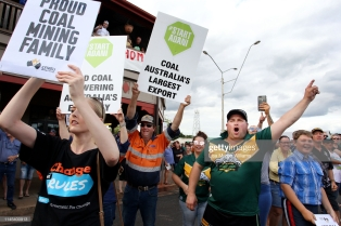 CLERMONT, AUSTRALIA - APRIL 27: Locals and pro-Adani supporters gather outside the Commercial Hotel to protest against anti-Adani environment activists as they arrive by convoy on April 27, 2019 in Clermont, Australia. Former Greens leader and conservationist, Bob Brown, has been leading a convoy of environmental activists through the Southern States towards Central Queensland as part of the #StopAdani movement. With primary concerns for increased coal ship travel through the Great Barrier Reef World Heritage Area, unlocking of the Galilee Basin and increase in carbon pollution. The proposed Adani Carmichael Mine, if approved will be constructed in the North Galilee Basin, 160kms north-west of regional town Clermont, its first stage is estimated to produce 27.5 million tonnes of coal per annum and will be transported via rail to Abbot Point which is situated 25km north of Bowen. (Photo by Lisa Maree Williams/Getty Images)